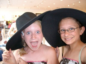Abby and Leanna playing dress up at the Mall
